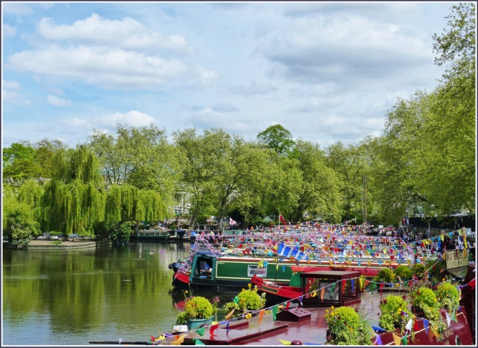 Canal with green trees and bright narrowboats