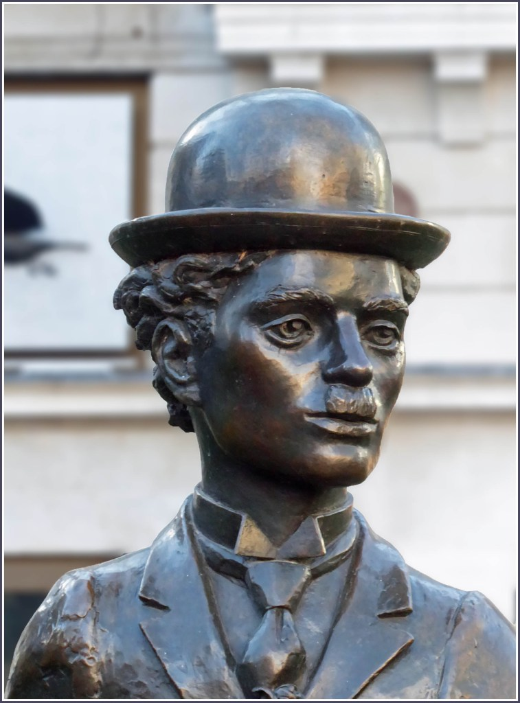 Statue of a man in a bowler hat