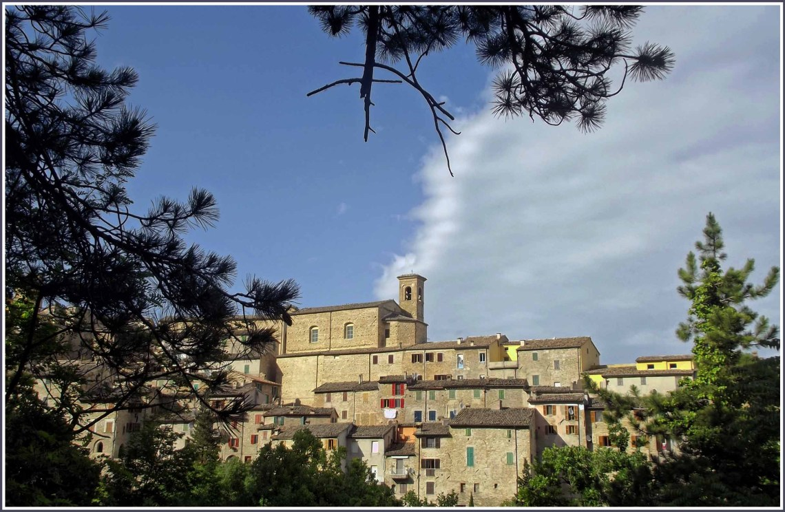 Typical Italian stone village surrounded by trees