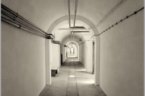 Long empty tunnel with subdued lighting