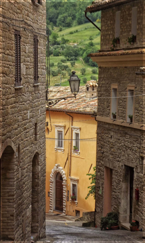 Steep narrow street between stone houses
