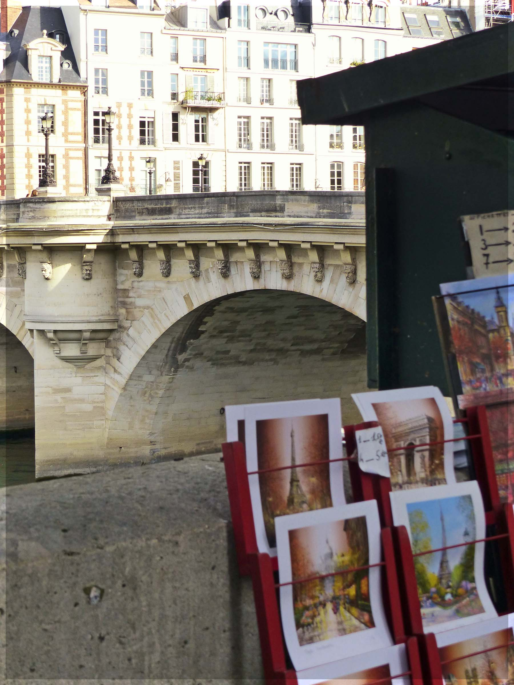 Stall selling pictures with bridge beyond