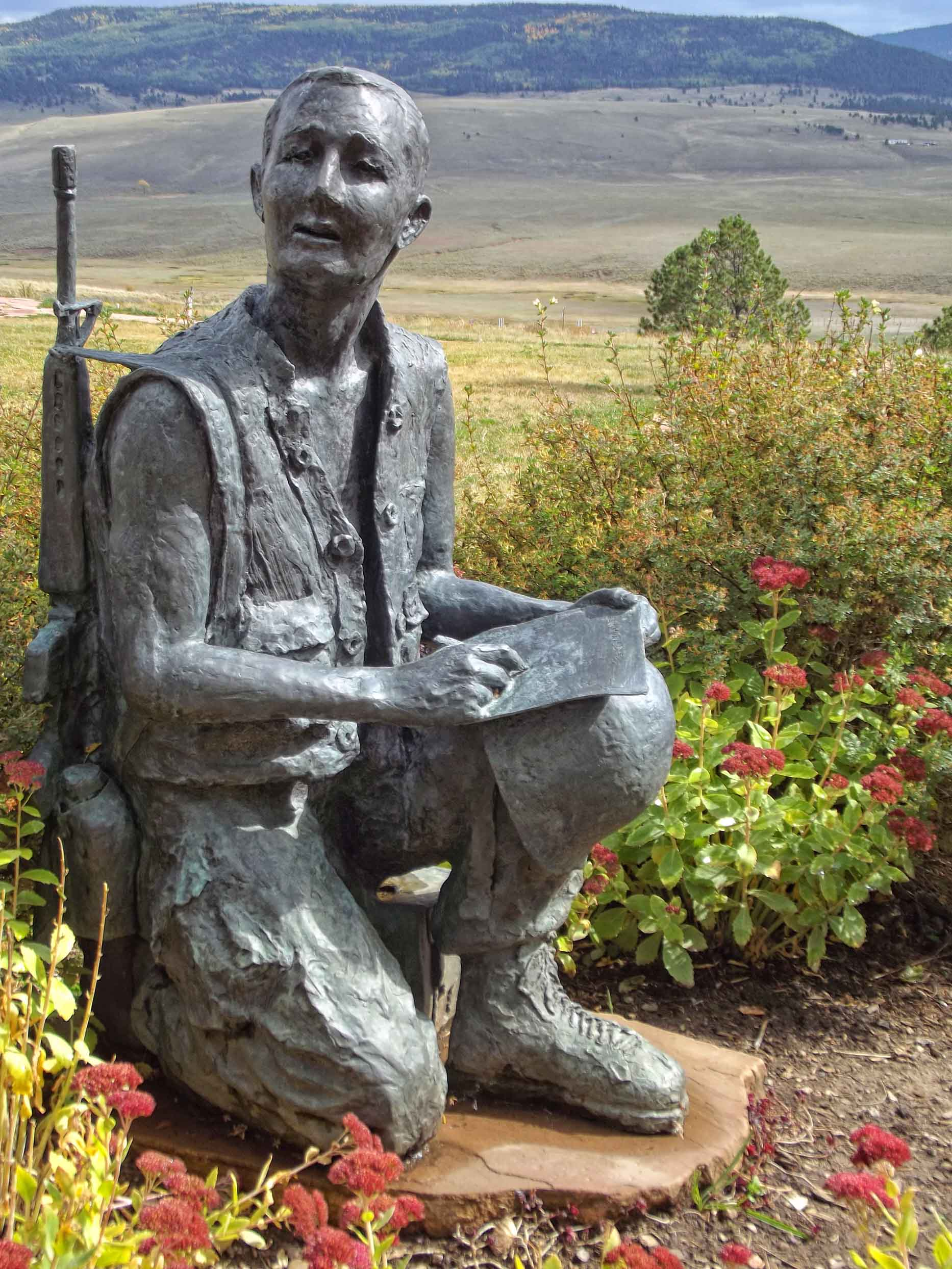 Statue of soldier writing a letter