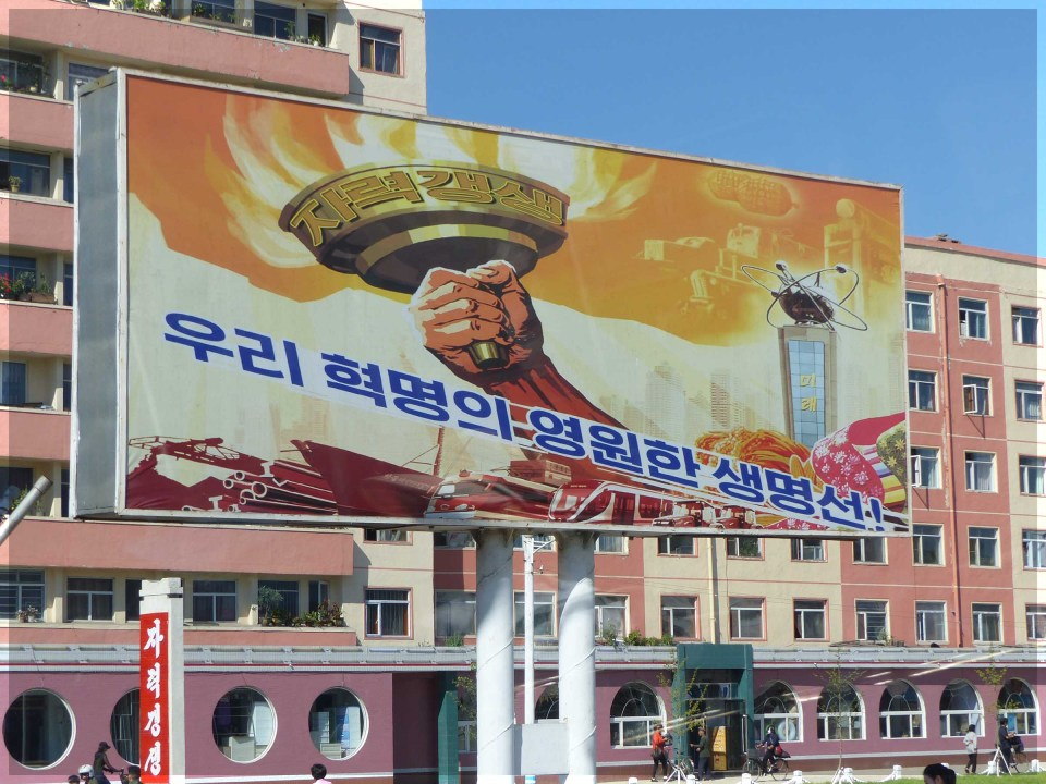 Large poster depicting arm holding a flaming torch