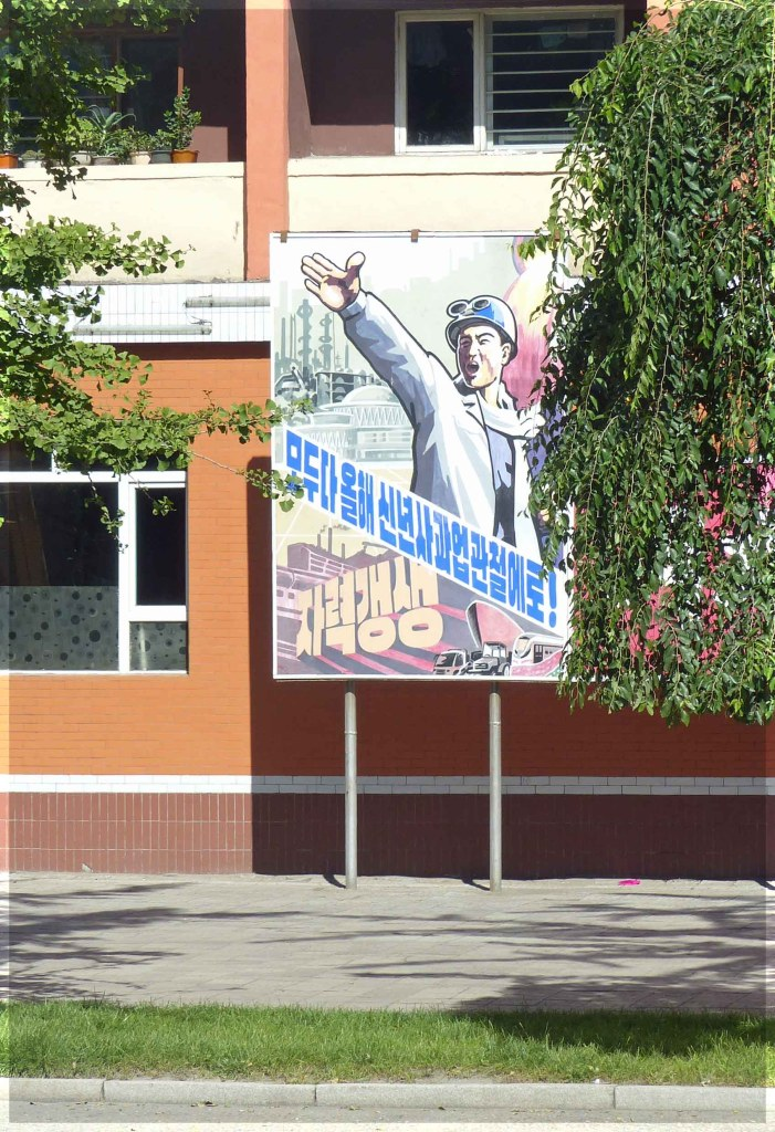 Large poster depicting man in white coat with arm raised