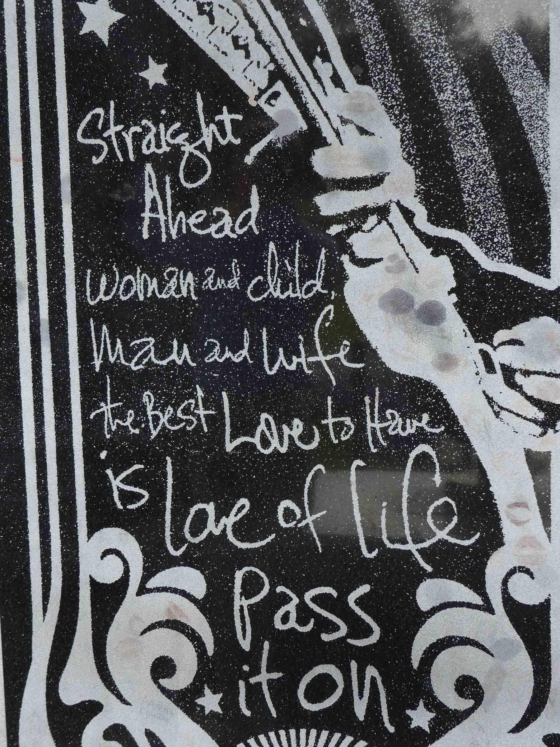 Marble slab with image of handwritten song lyrics