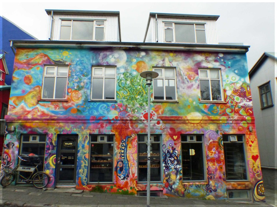 Building covered in colourful murals