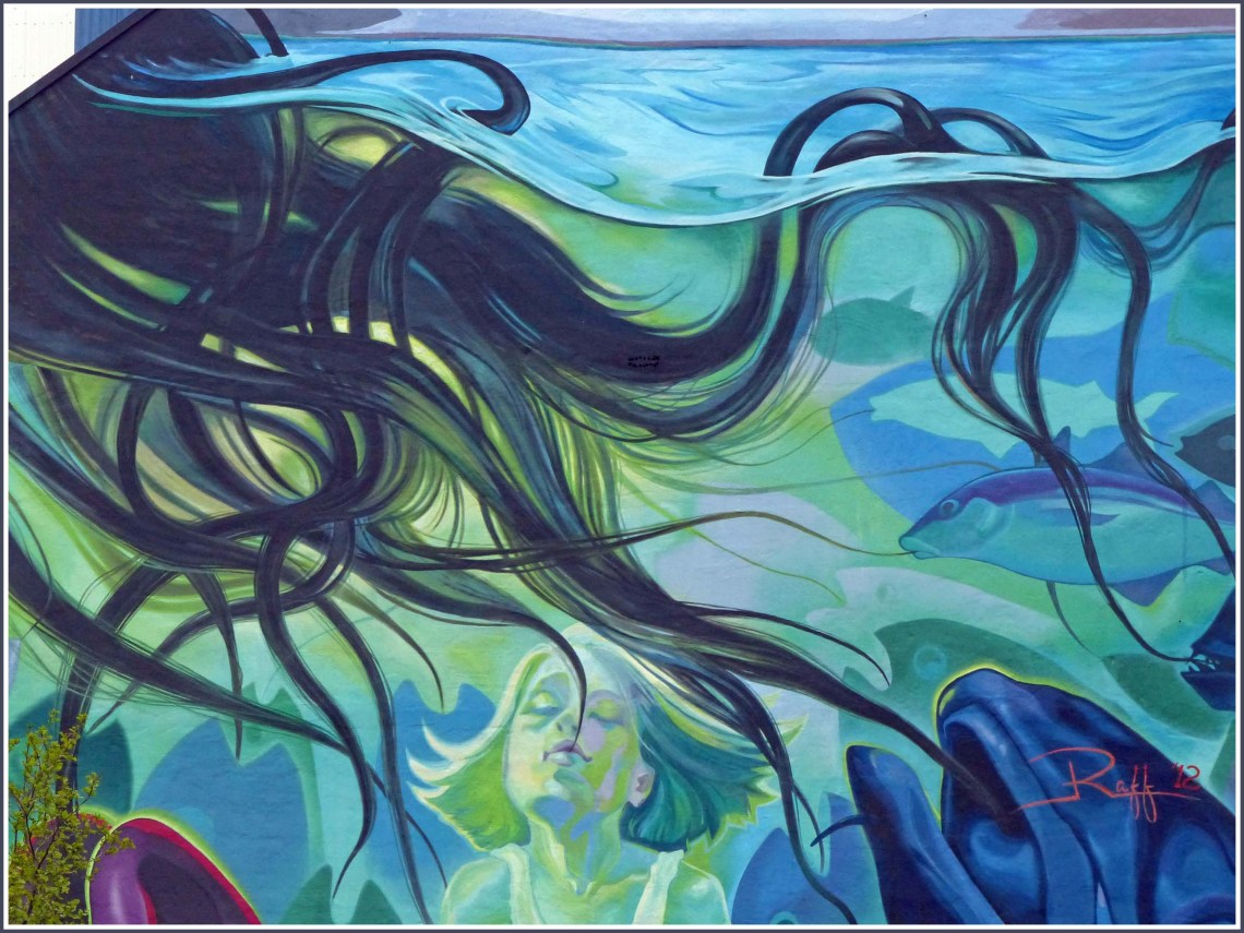 Colourful mural in blues and greens