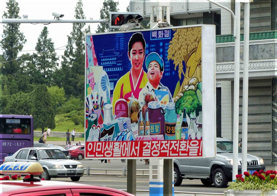Large poster depicting mother and child with groceries