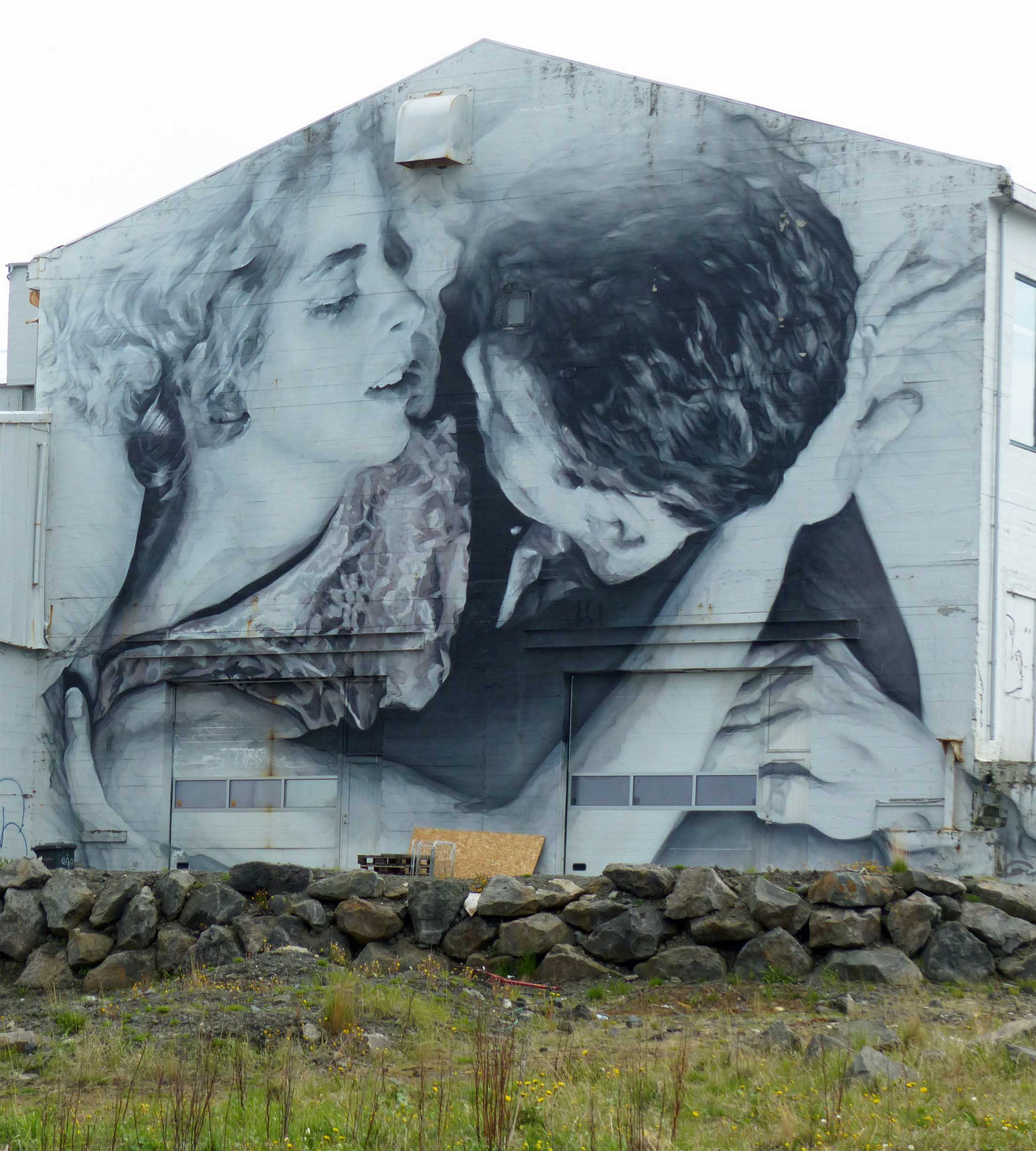 Huge black and white mural on an old building