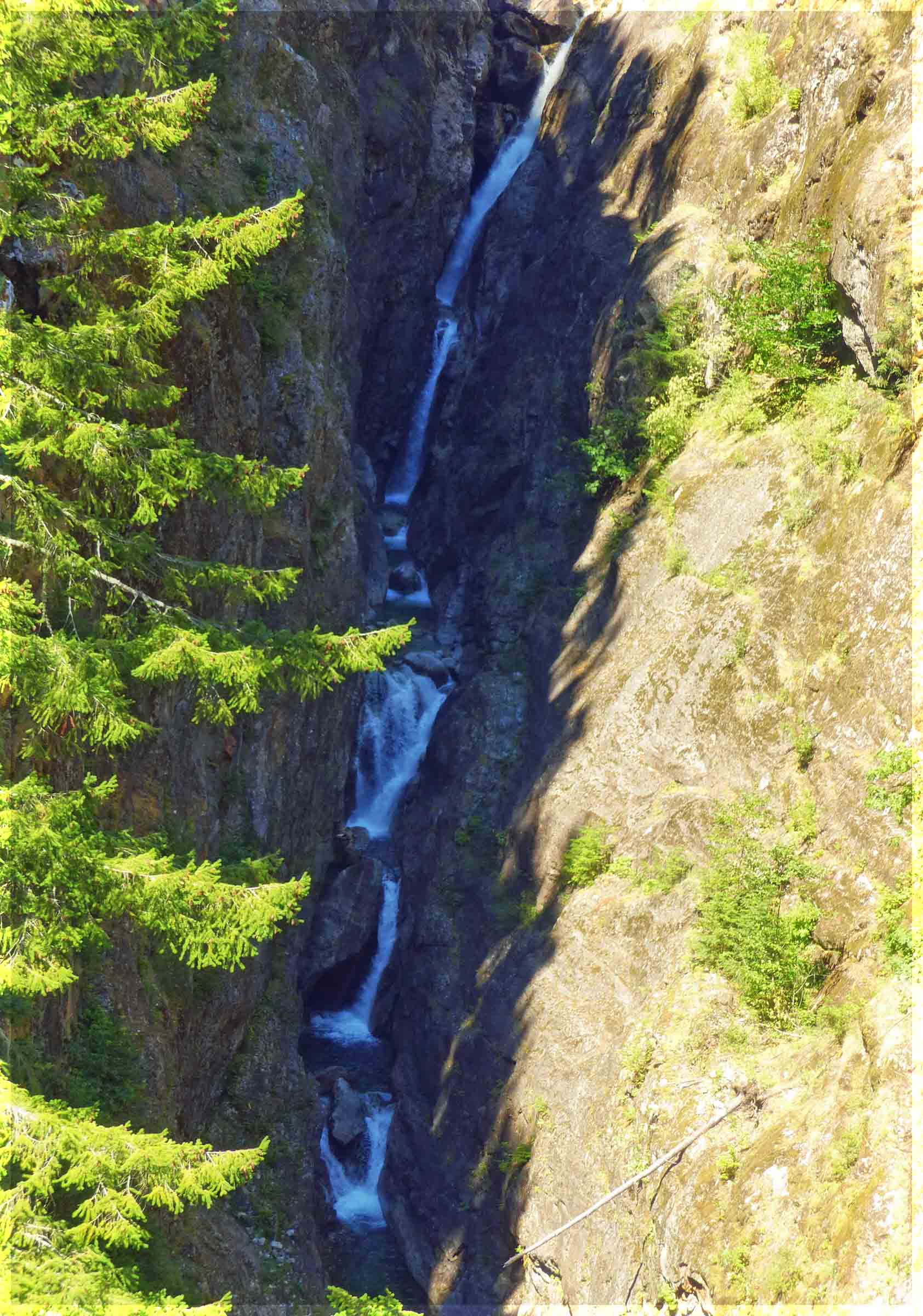 Narrow chasm with waterfall