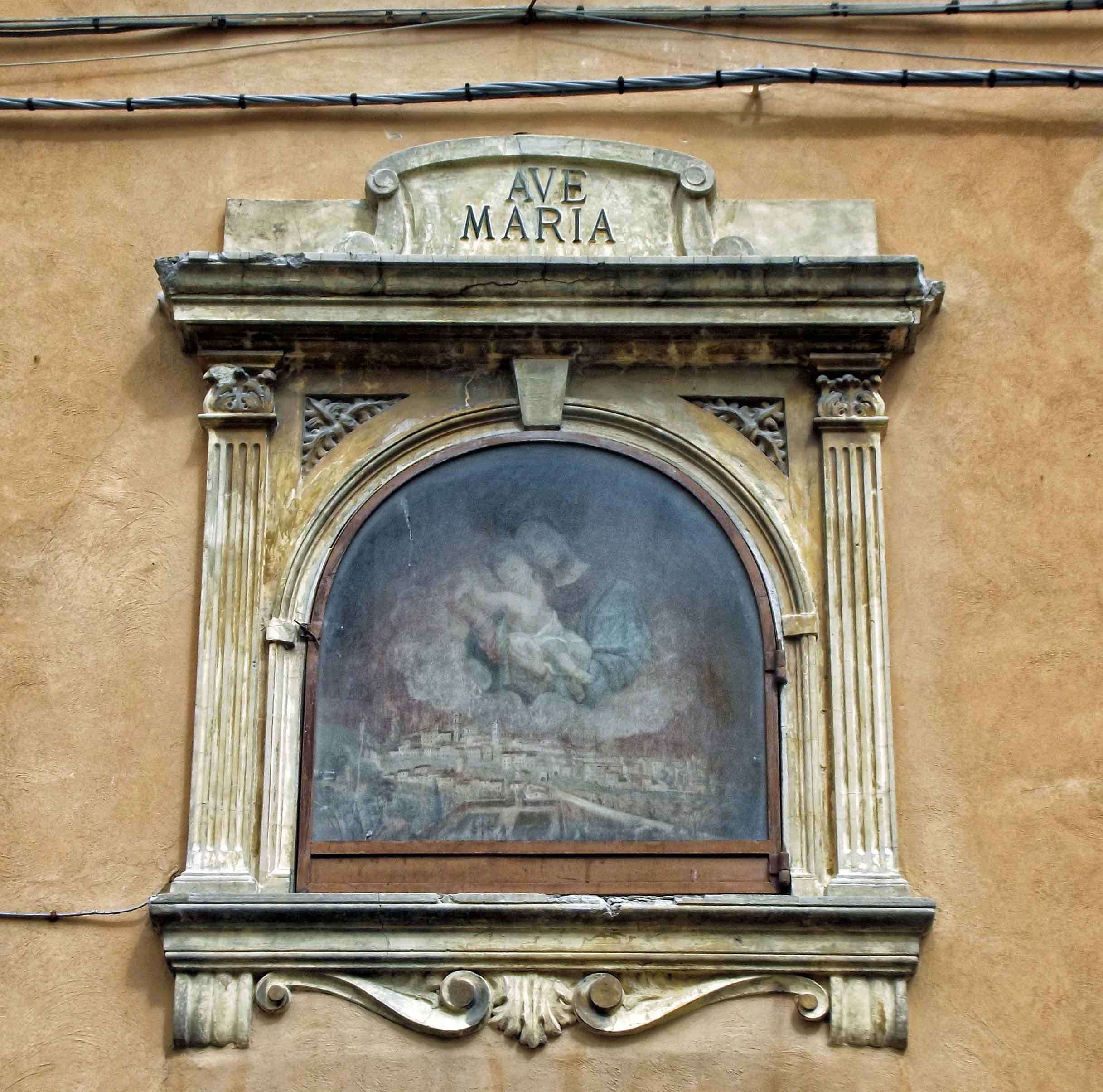 Picture of Mary and Jesus in a frame on a house wall