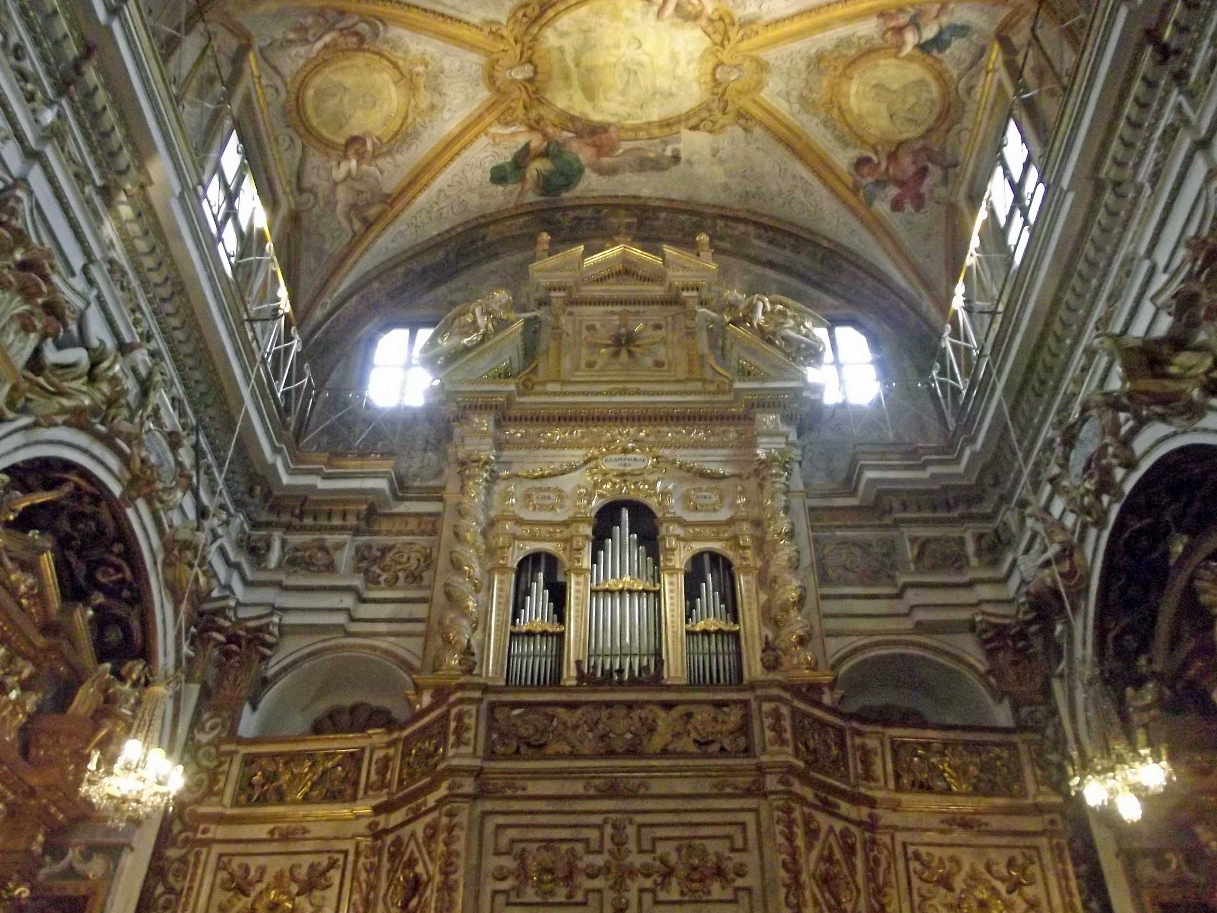 Chruch organ and ornate ceiling above