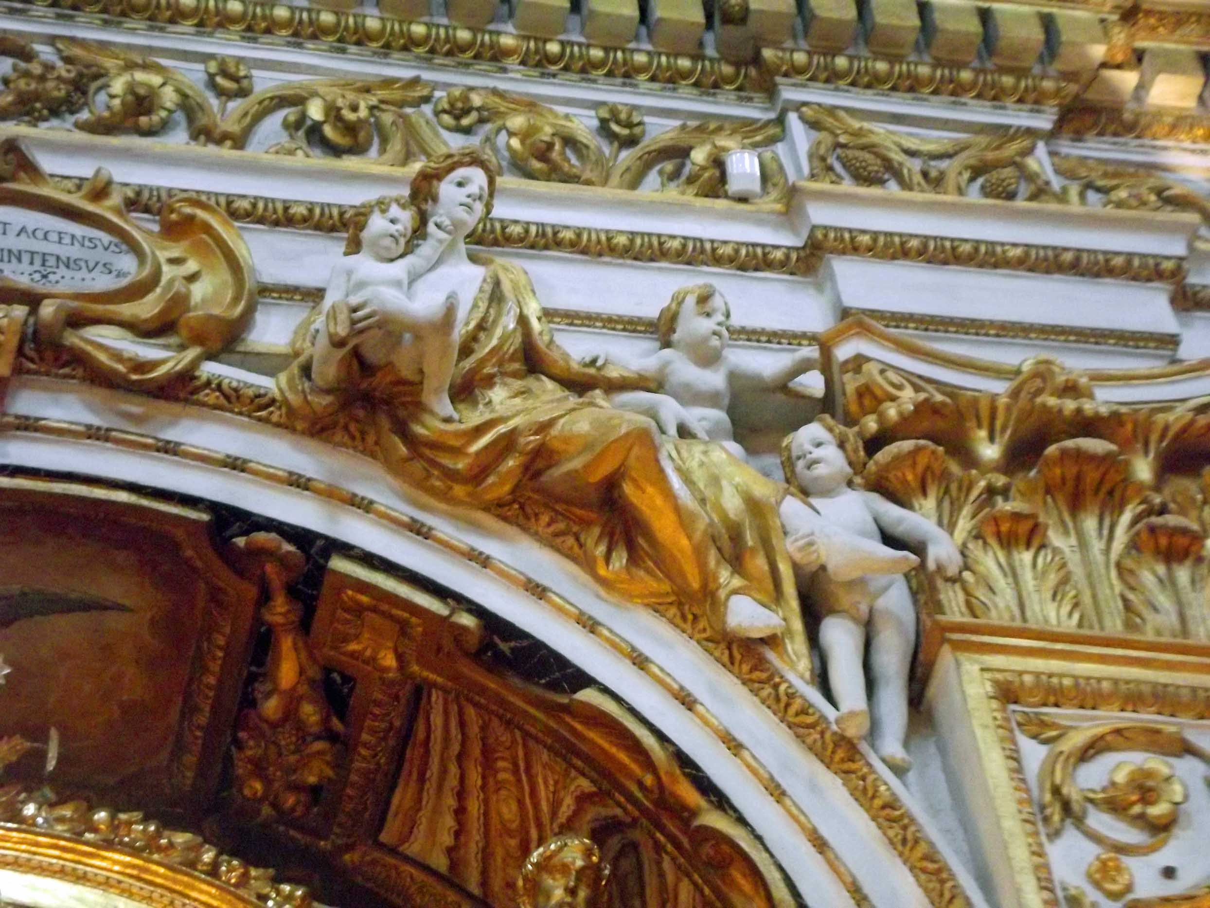 White and gold church decorated wall with cherubs