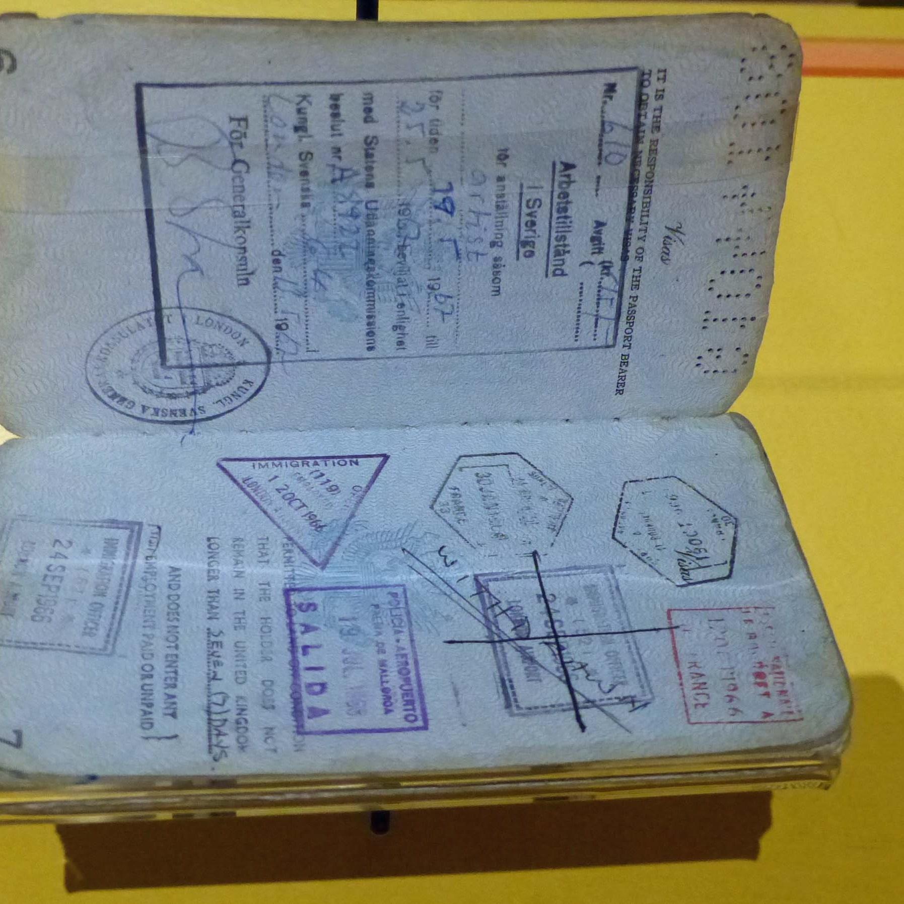 Open passport in a glass cabinet