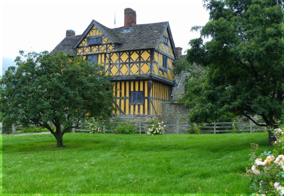 Yellow half-timbered house in a garden
