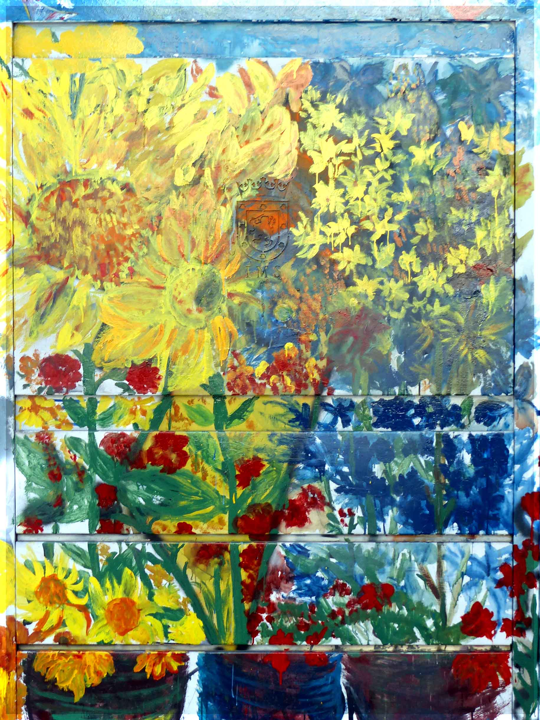 Colourful wall painting of yellow and red flowers