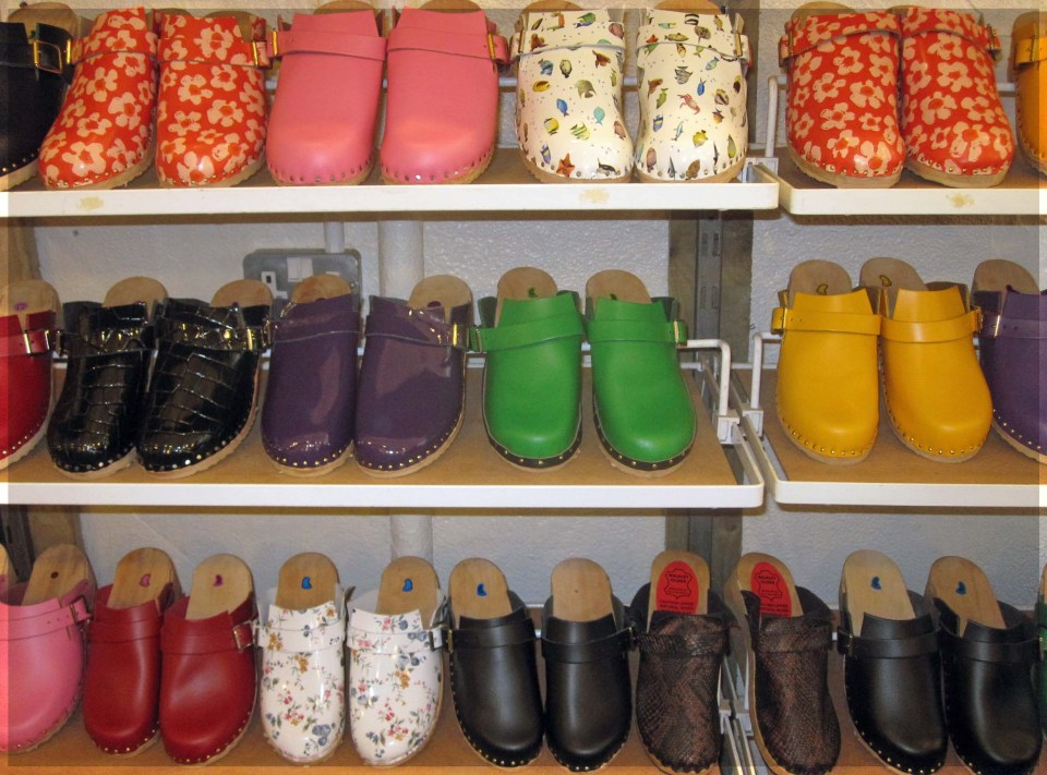 Shelves of brightly coloured leather clogs