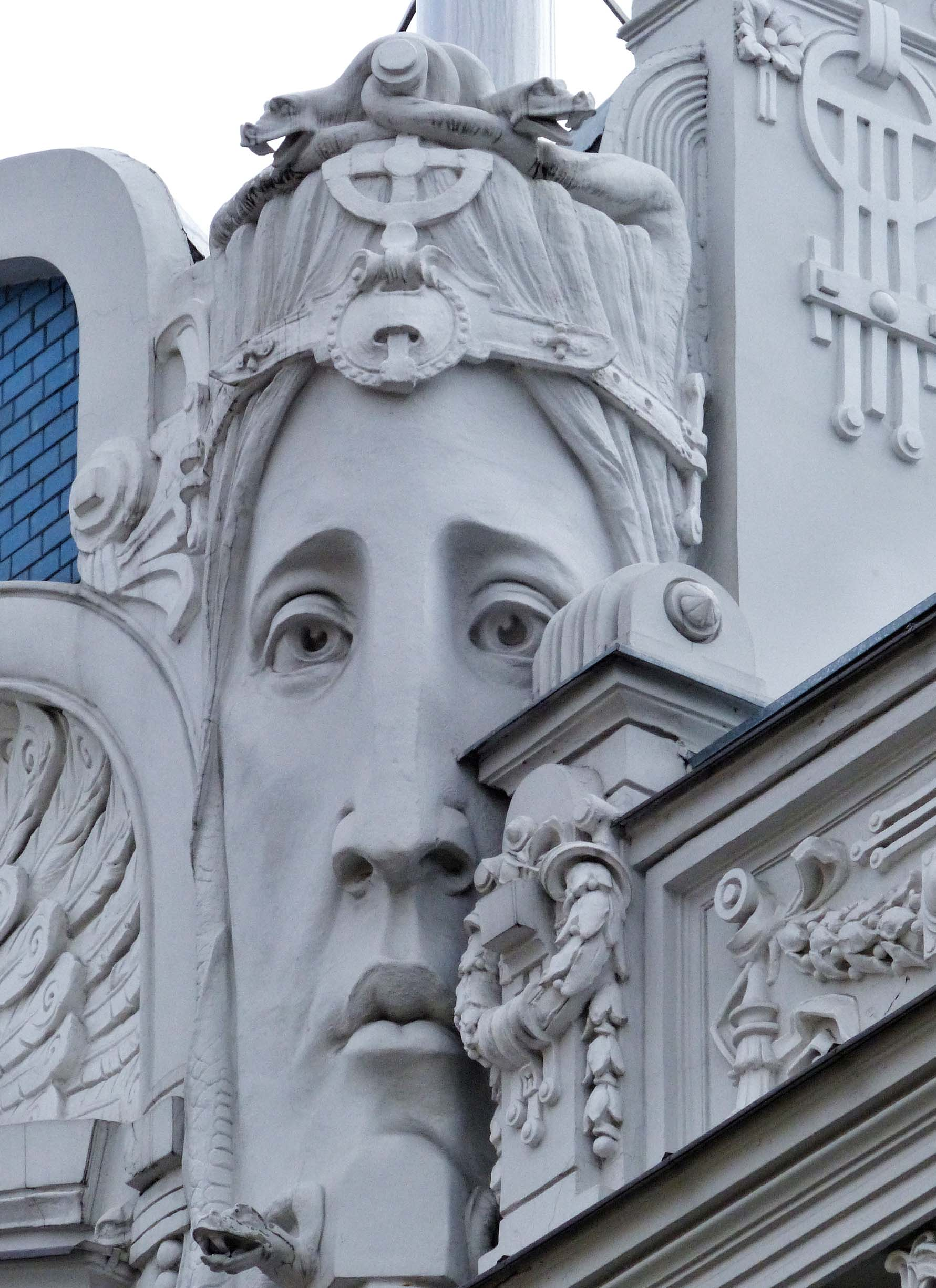 Large female face carved in white stone