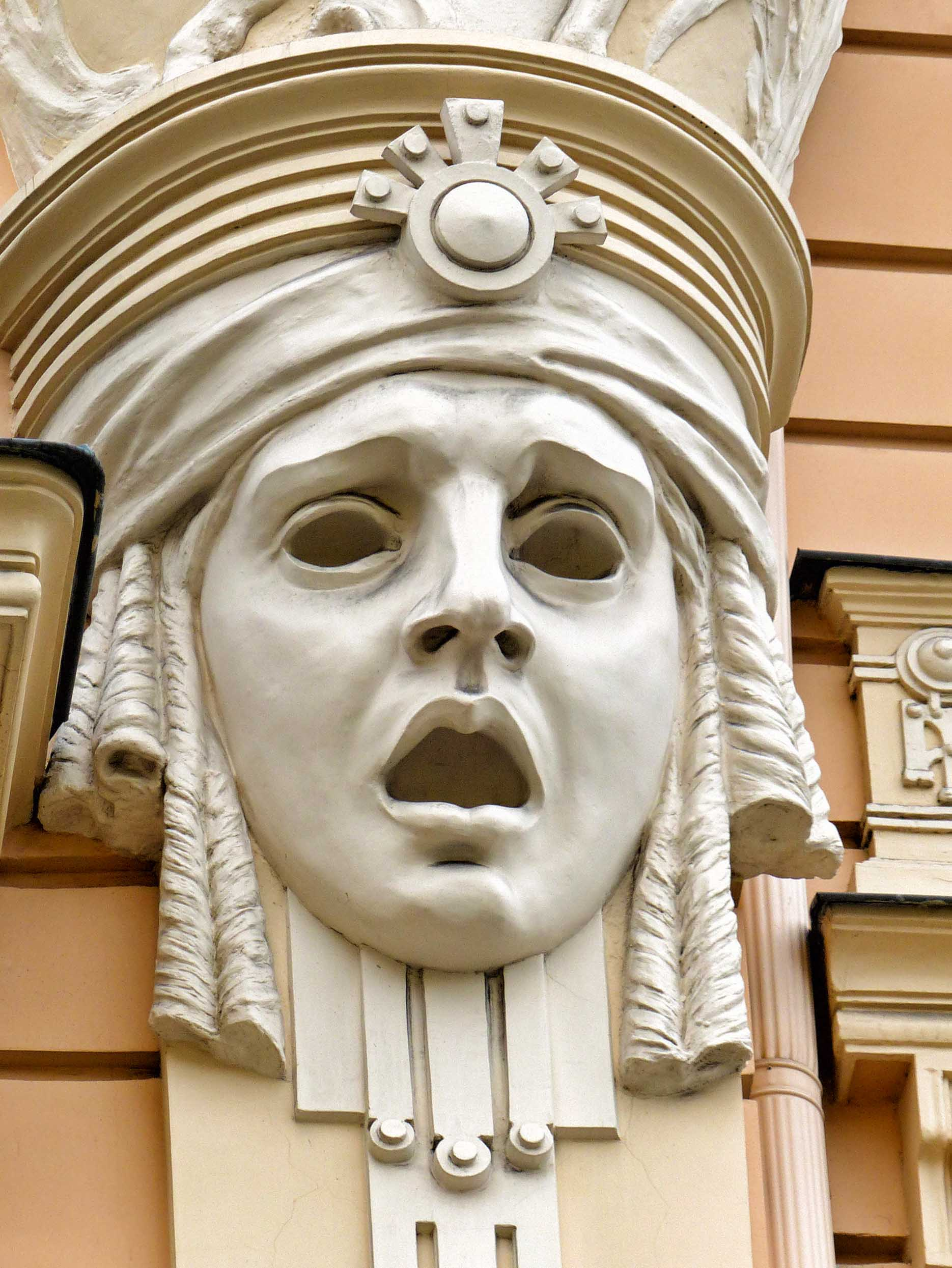 Large stone face on a cream building