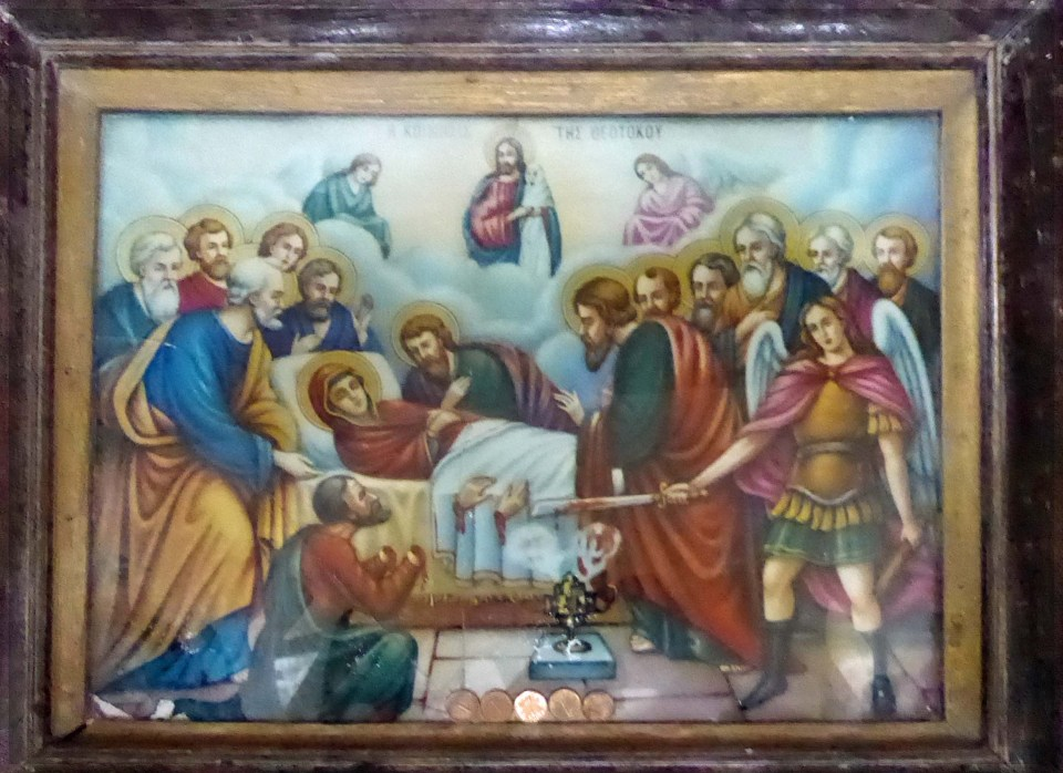 Religious painting in a wooden frame