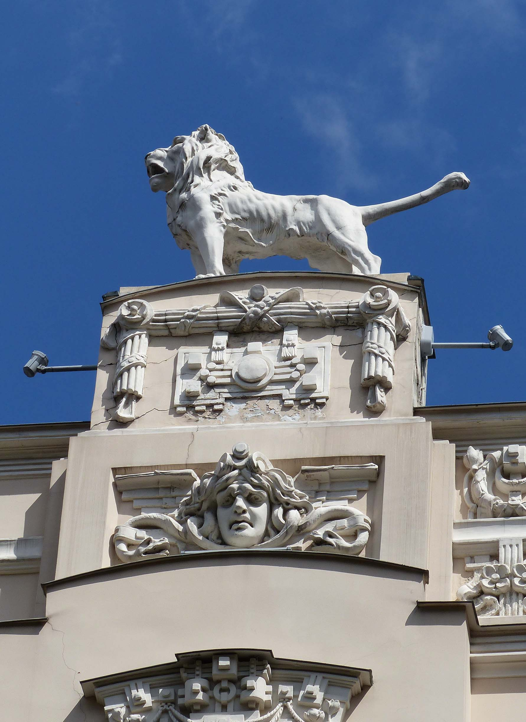 Large carved lion on top of a building