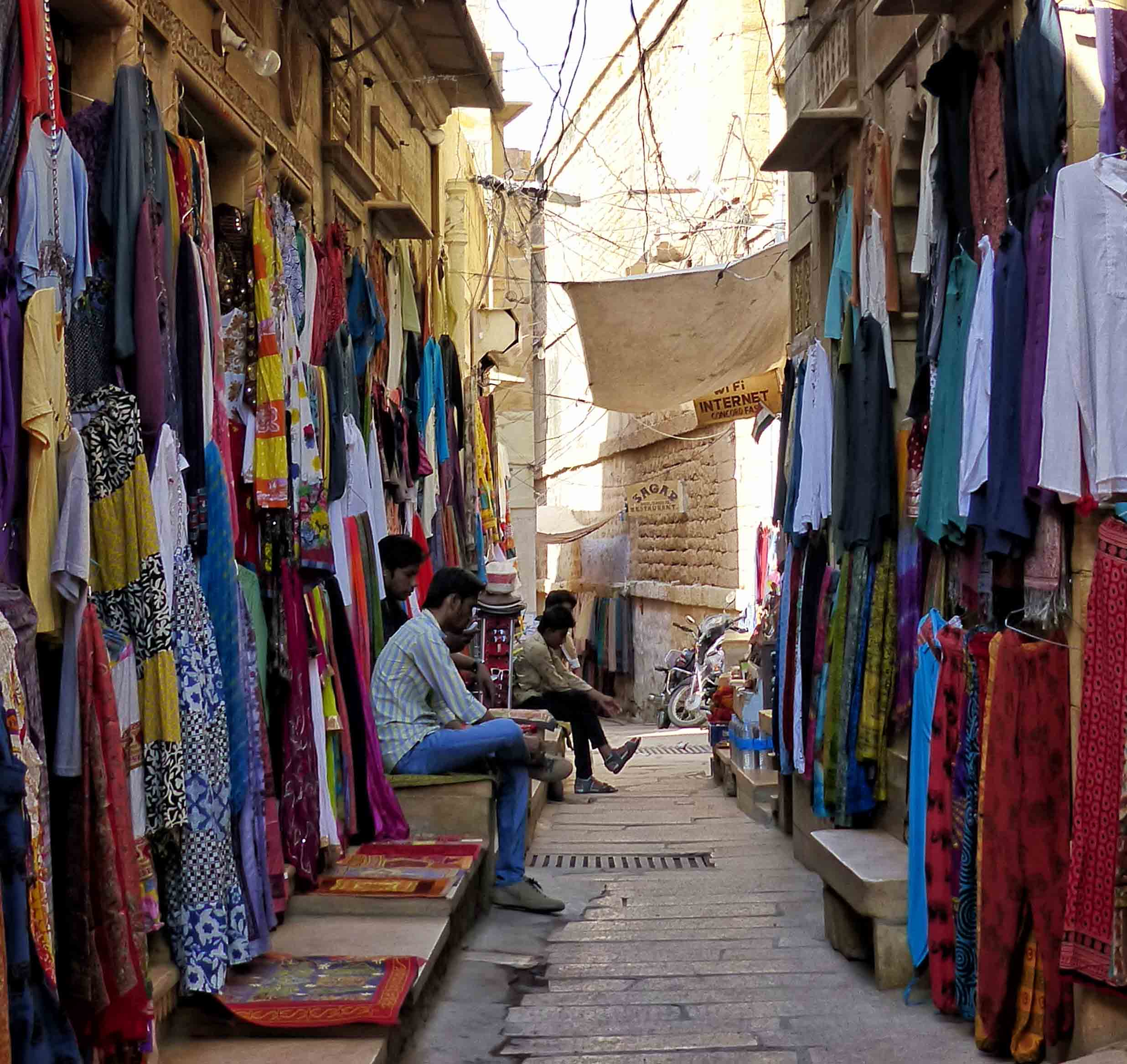 Narrow street with shops selling clothes