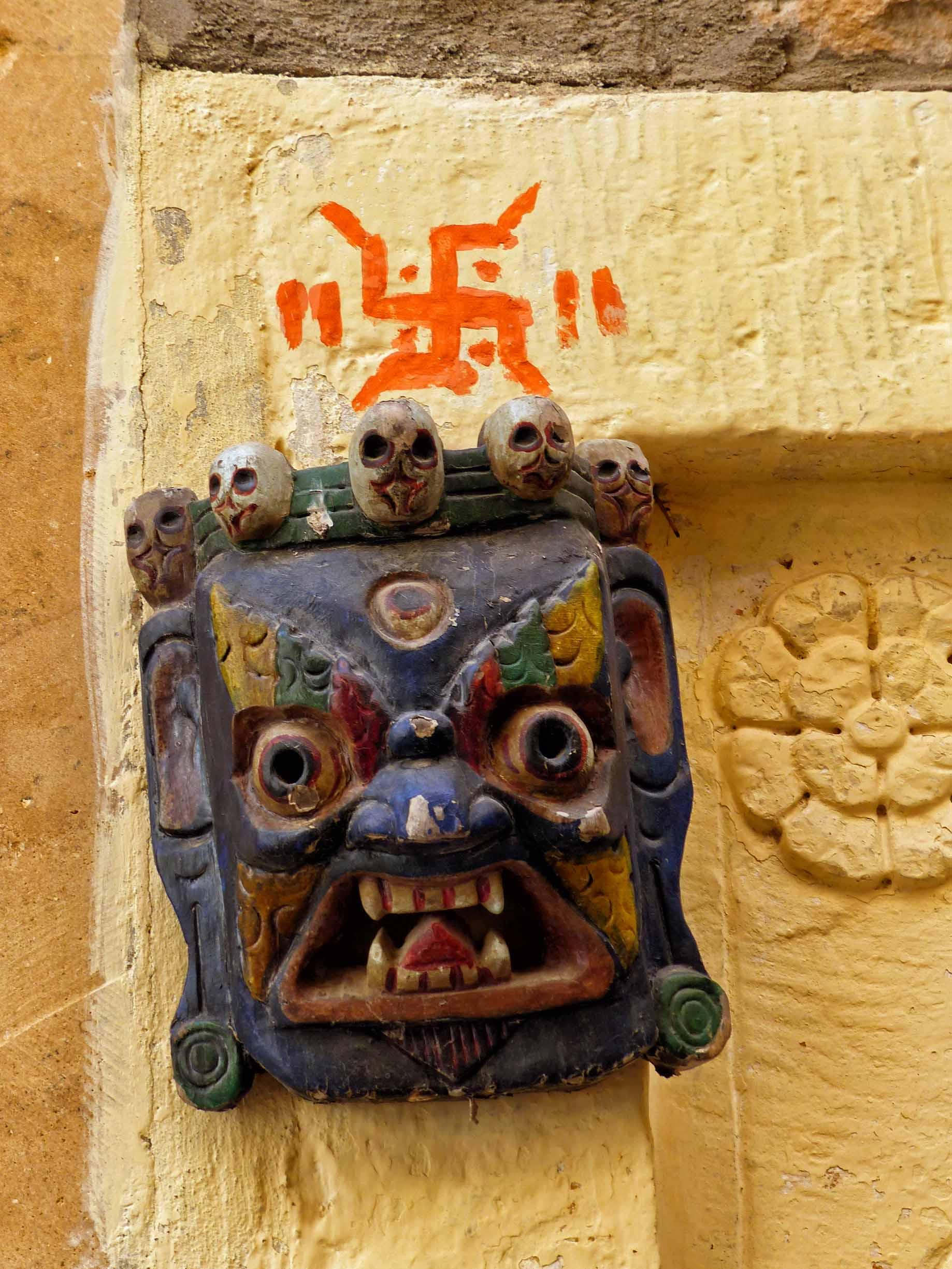 Small mask and Hindu swastika