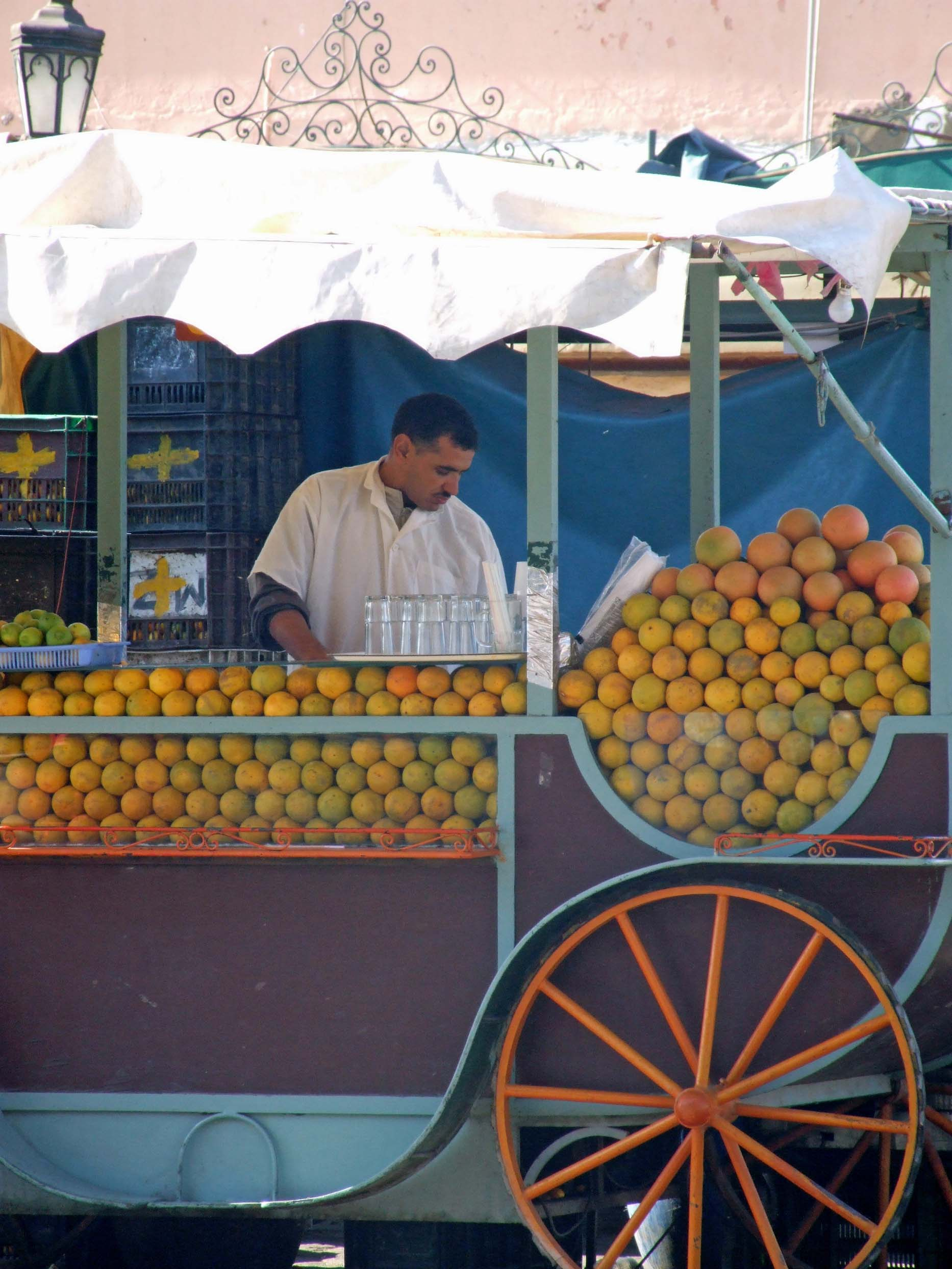 Stall with piles of oranges