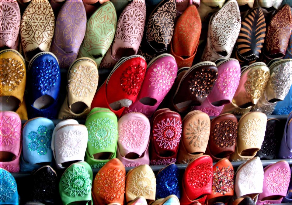 Rows of leather slippers hanging up