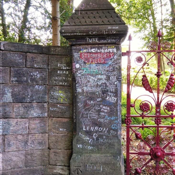 Stone gatepost with graffiti