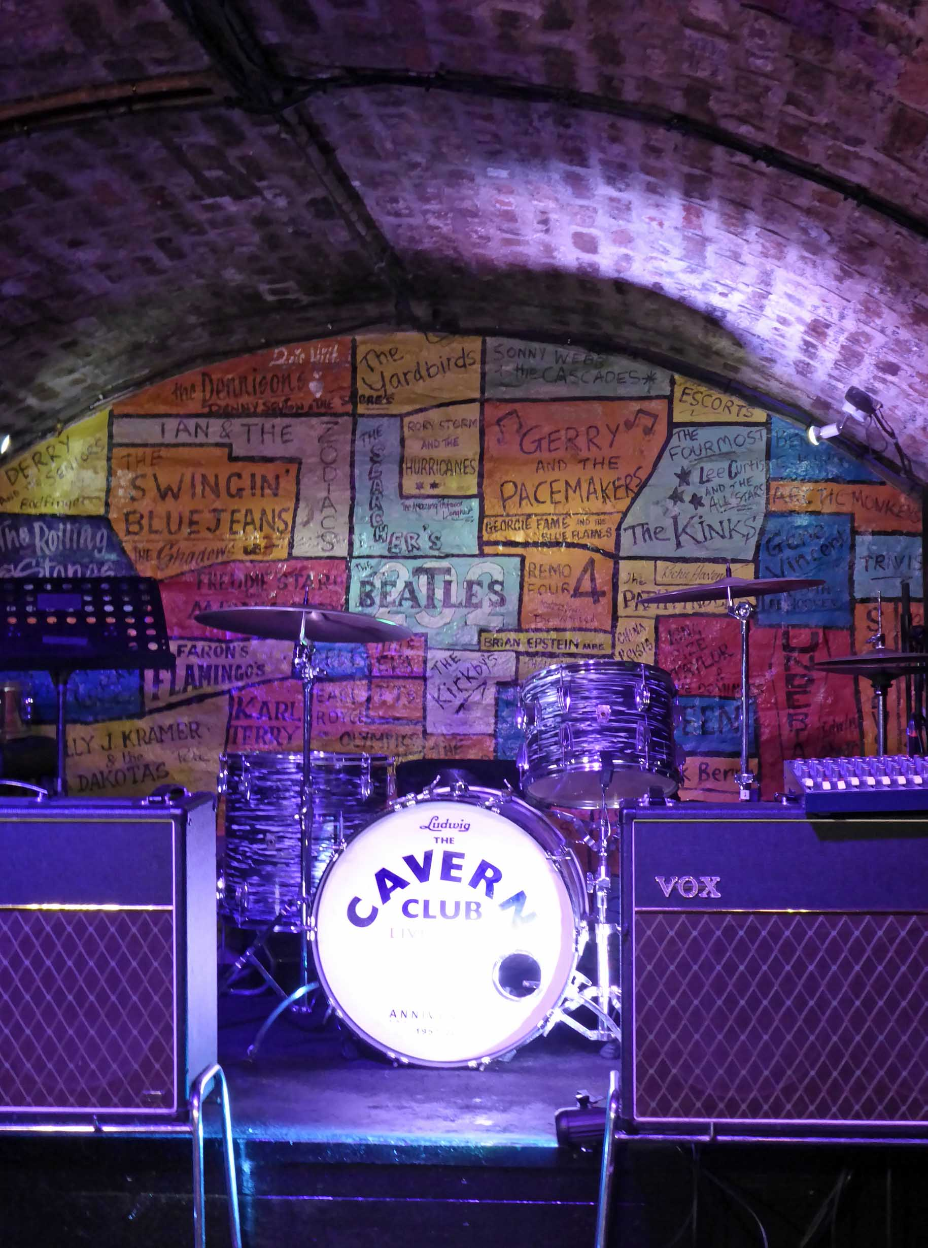 Blue-lit stages with drum kit