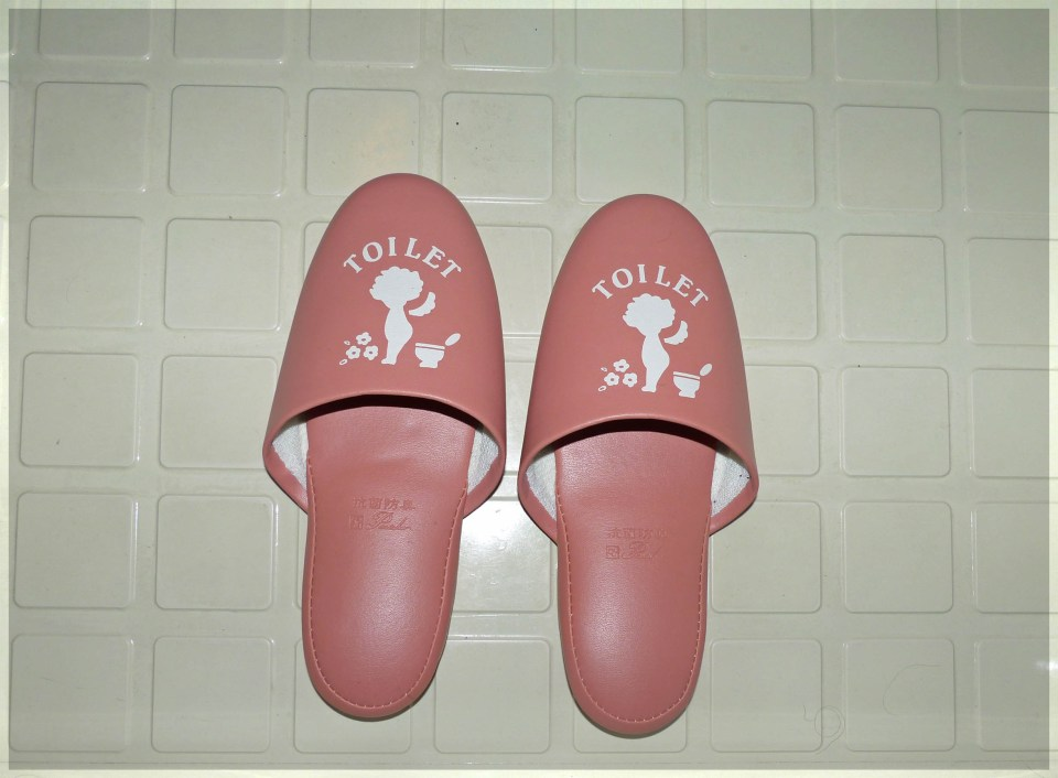 Pink slippers on a tiled floor