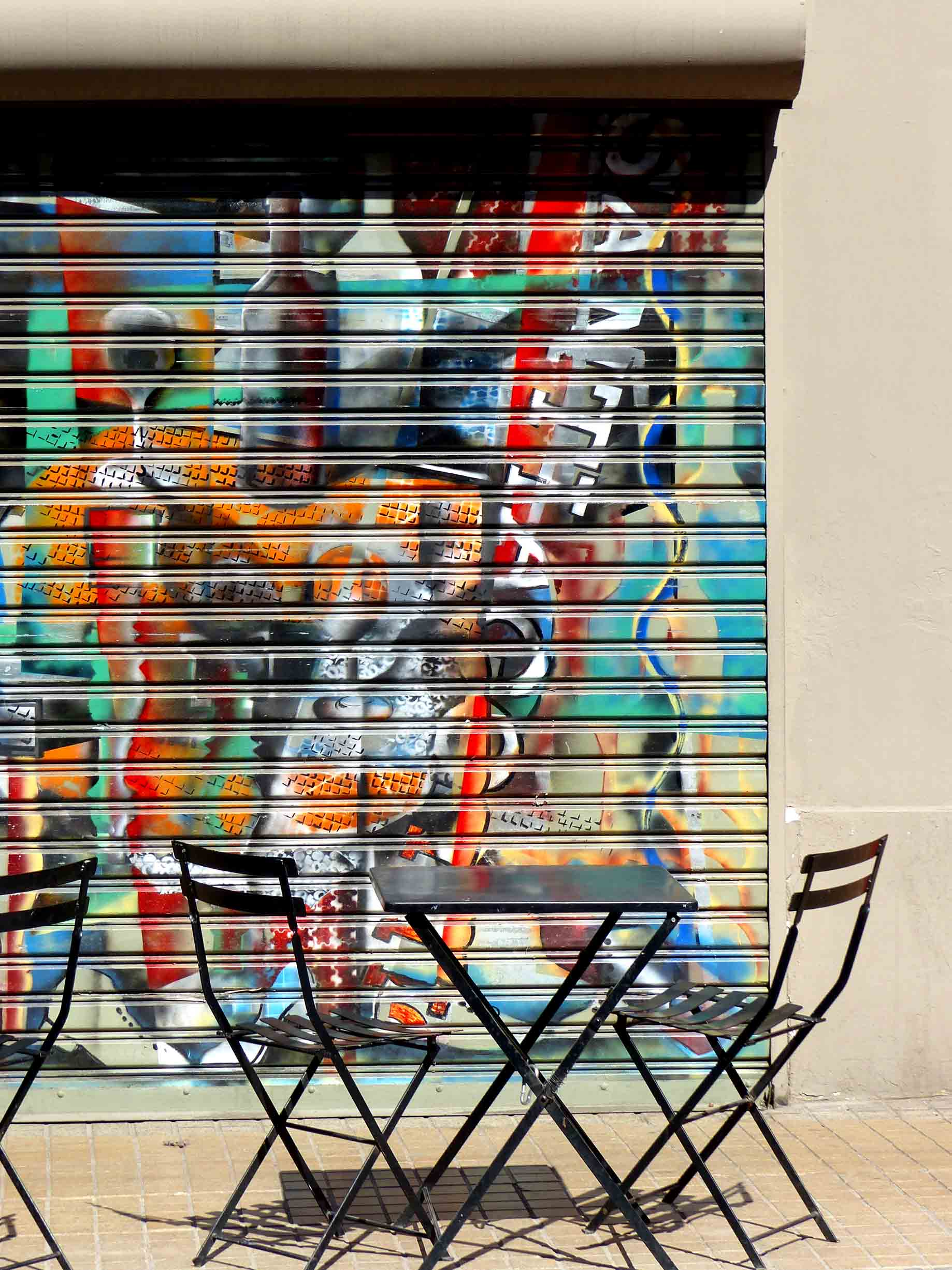 Painted shutters and cafe table and chairs