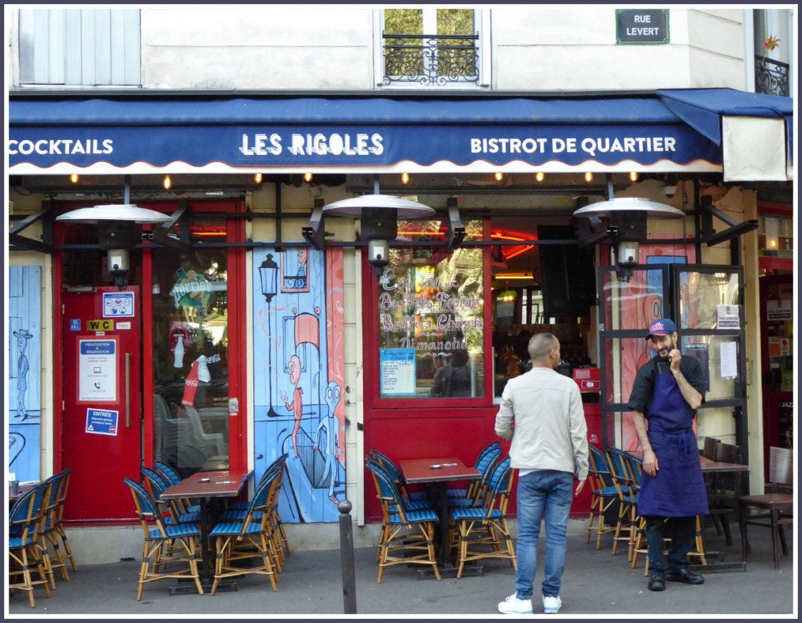 Colourful cafe with two men talking outside