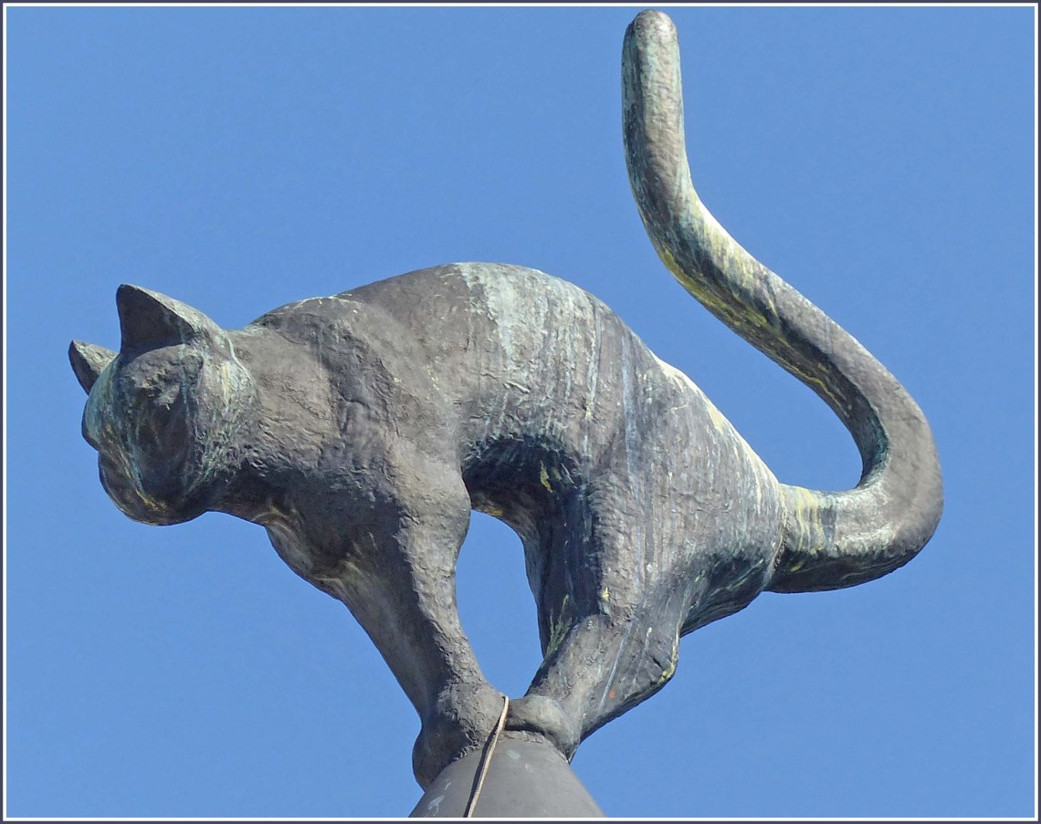 Sculpture of a cat on a roof