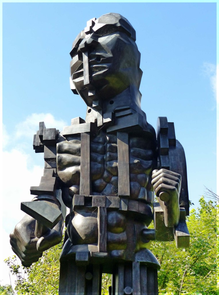 Large sculpture of a robot-like figure