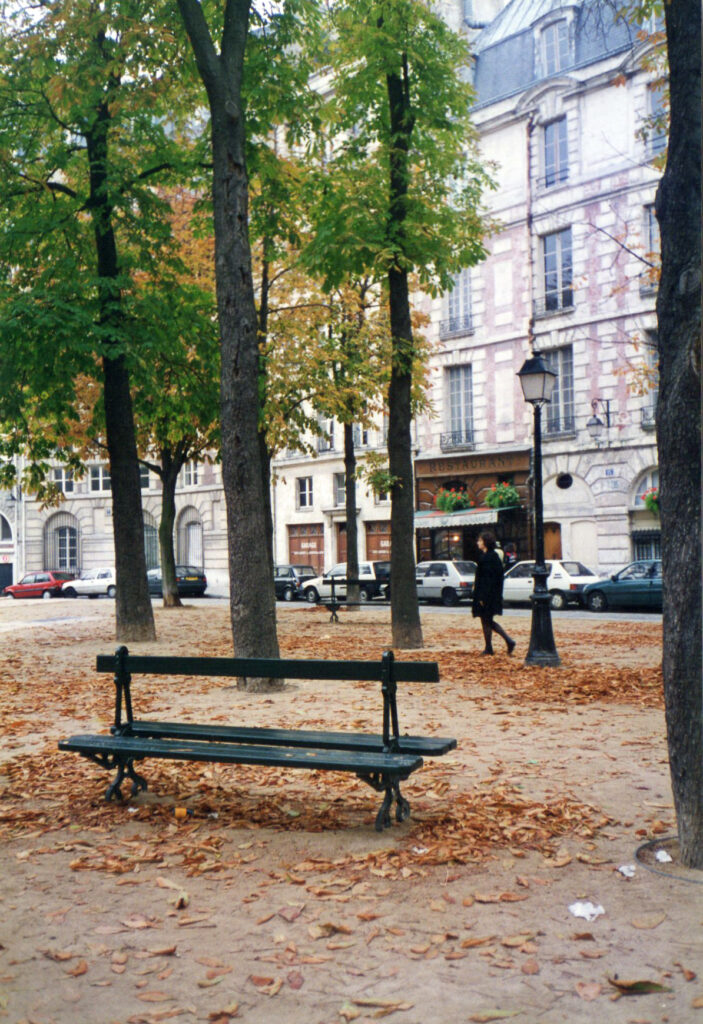 Square with a bench and autumn trees