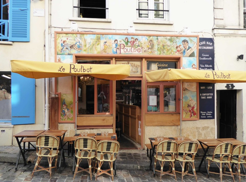 Colourful cafe with tables and chairs outside