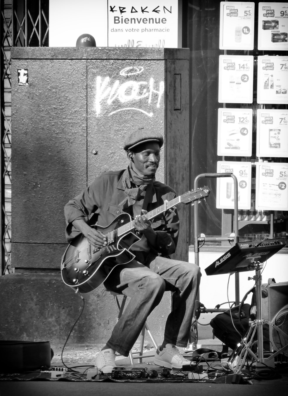 Black and white photo of a man playing guitar
