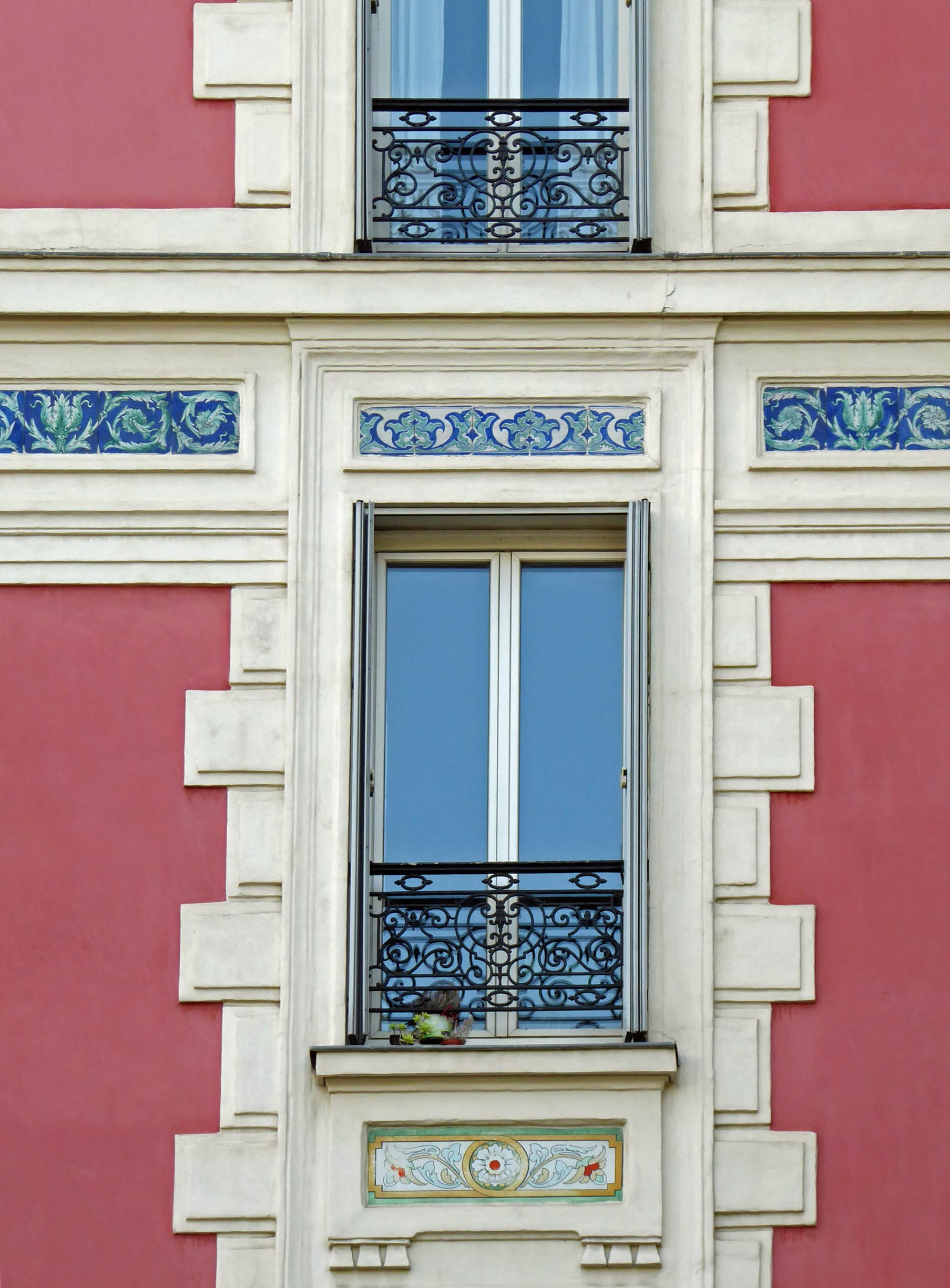 Window with railing and decorative frieze