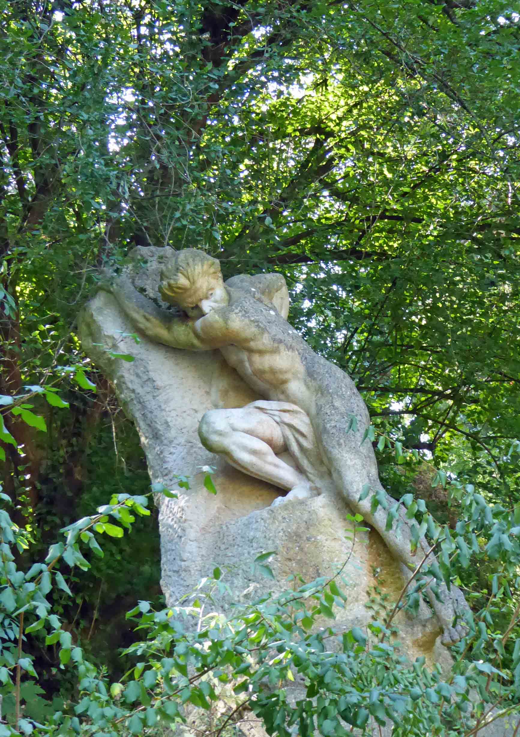 Sculpture of a man clinging to a rock
