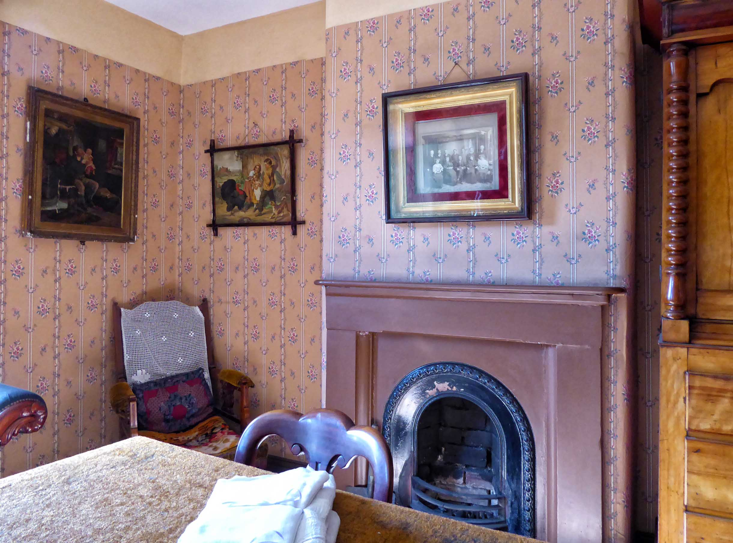 Old-fashioned room with fireplace