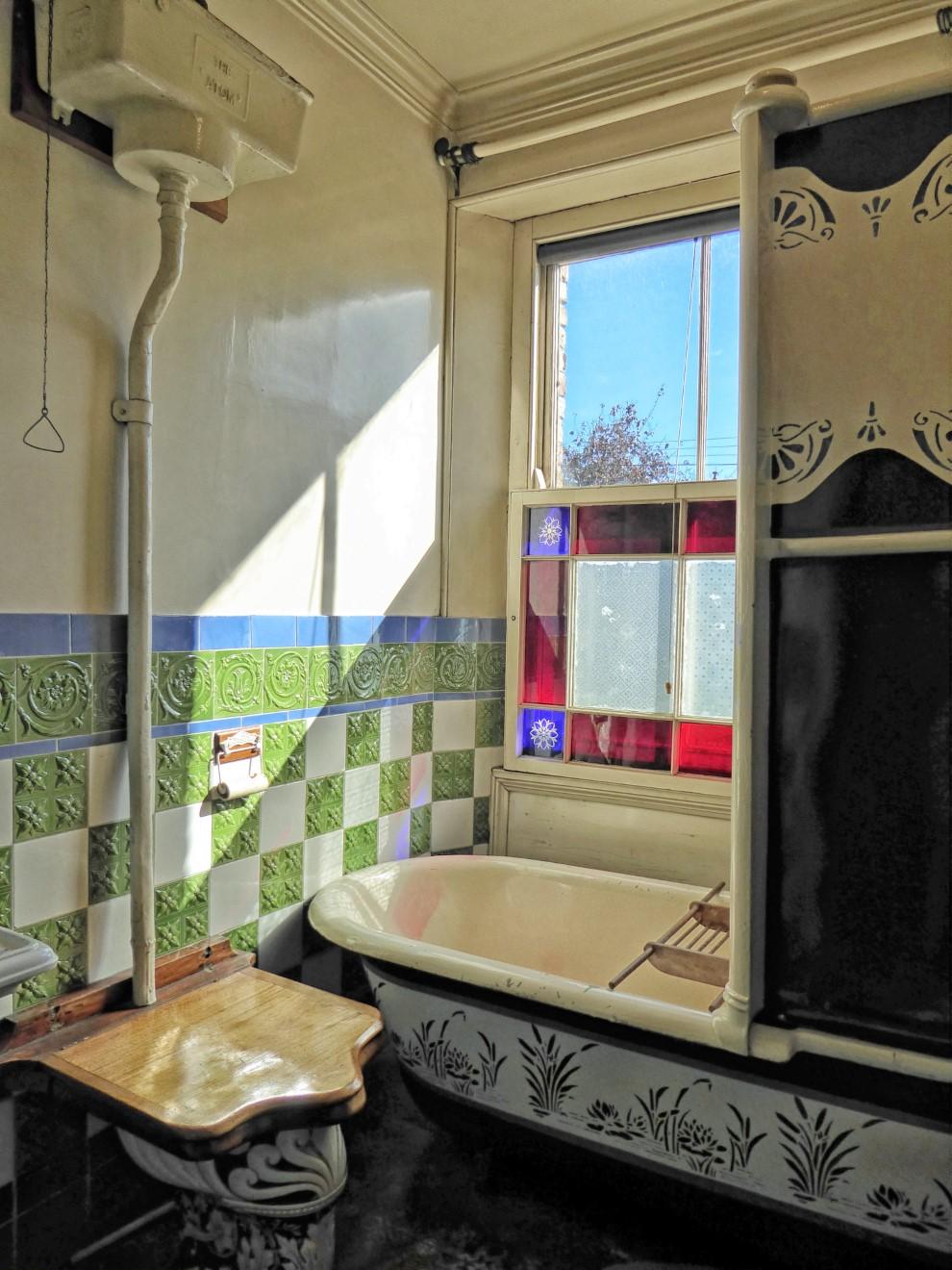 Old-fashioned bathroom with ornate bath
