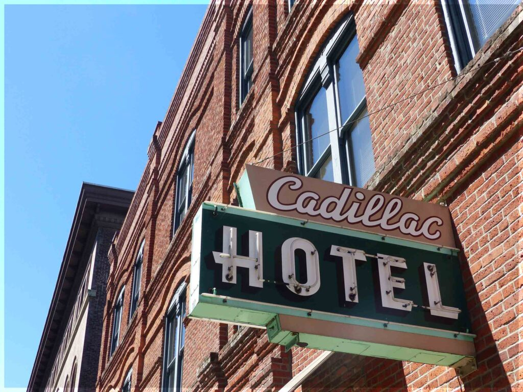 Cadillac Hotel sign on brick building