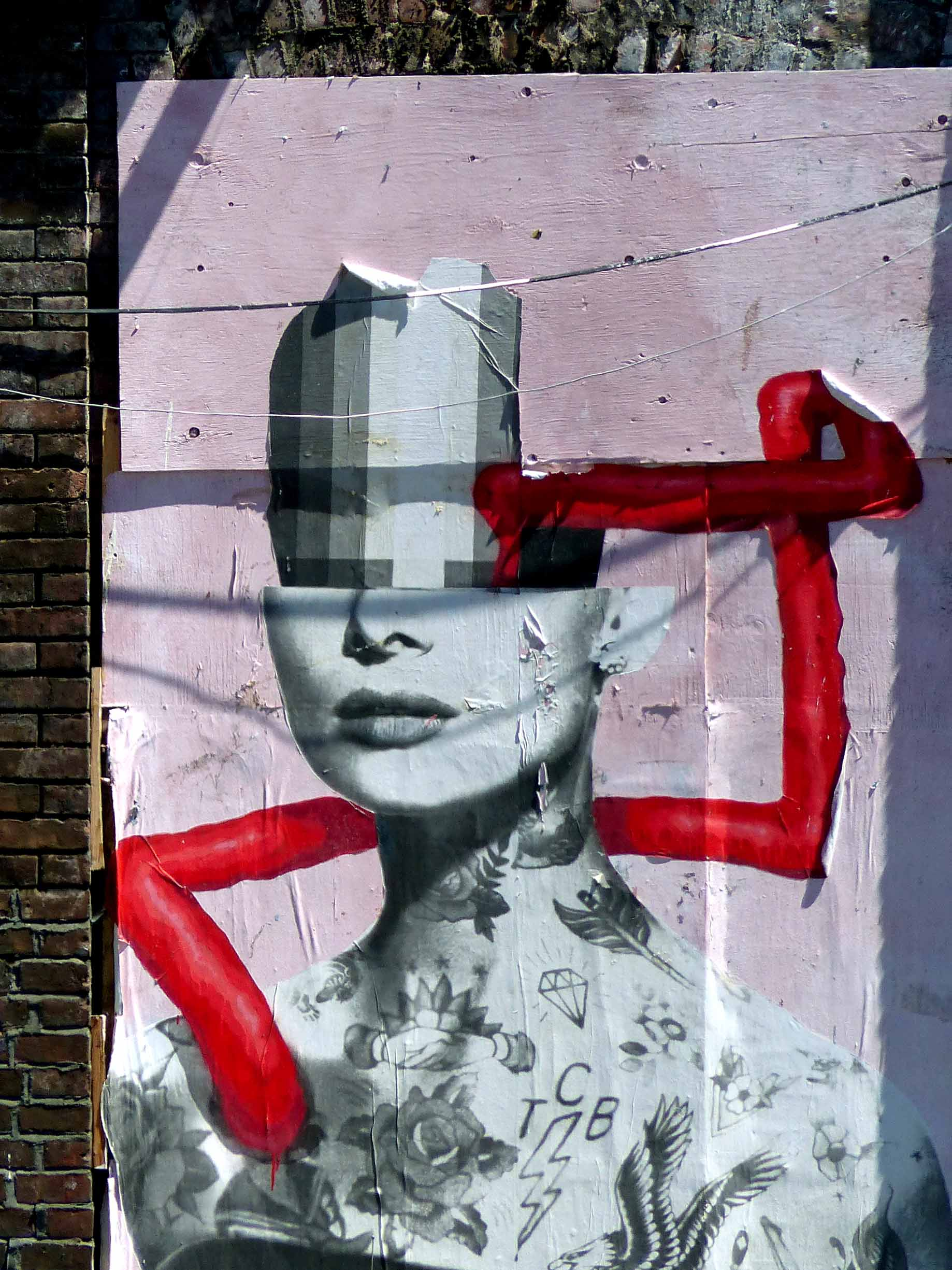 Wall painting of woman with red paint