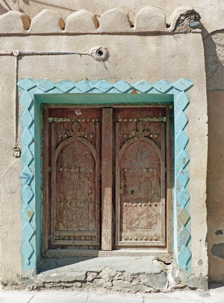 Wooden door with turquoise painted frame