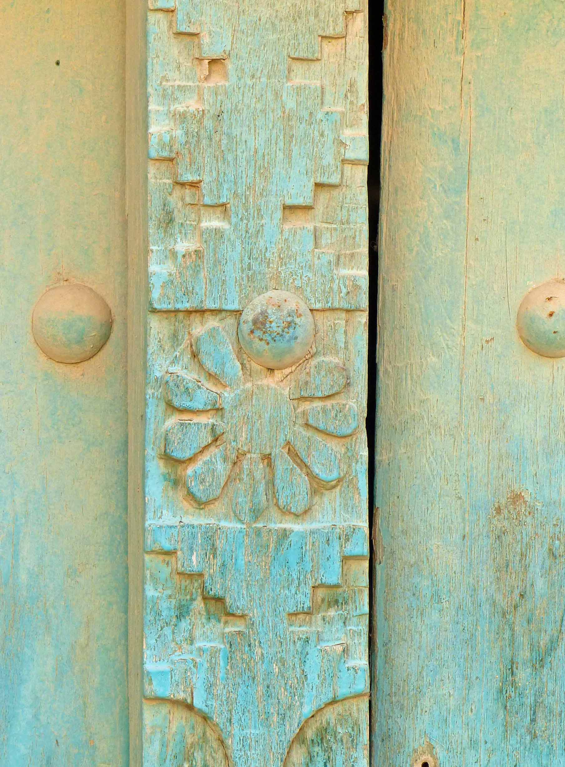Carved wood painted turquoise