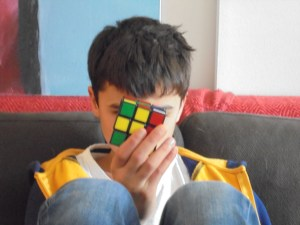 Boy sitting with a Rubick's cube