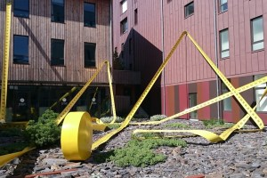 """Mètre à Ruban"" is a fun giant tape measure in front of a building company on the Ile de Nantes"